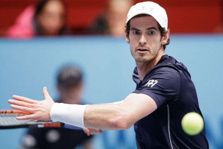 Andy Murray returns the ball to John Isner during their quarter final match at the ATP tennis tournament in Vienna on Oct 28, 2016.