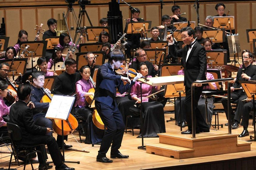 Violinist Joshua Bell with the Singapore Chinese Orchestra, under the baton of music director Yeh Tsung during a performance held at the Esplanade Concert Hall on April 9, 2016.