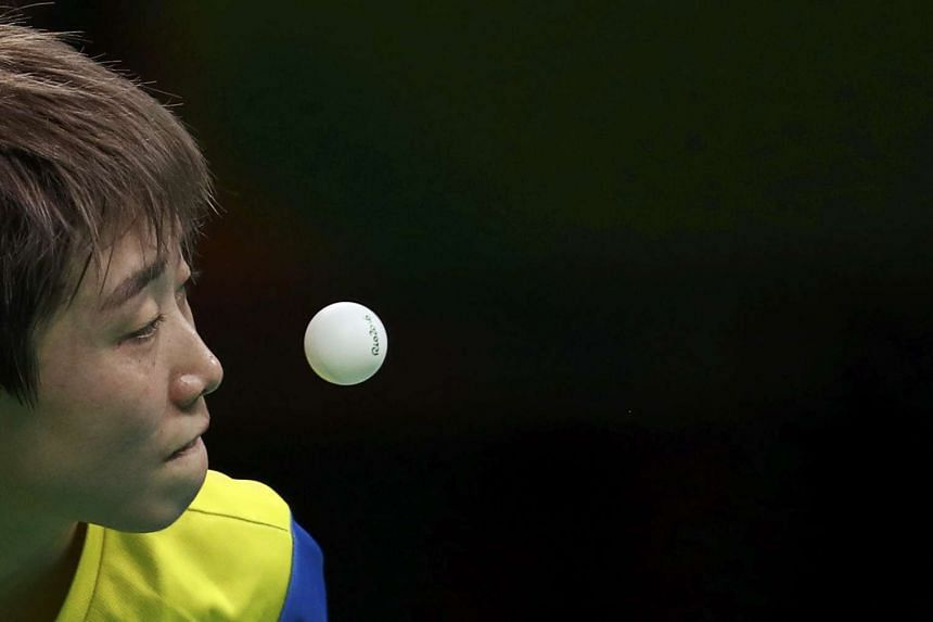 Feng Tianwei eyes the ball during play against Ai Fukuhara of Japan during the Women's Table Tennis quarterfinals at the 2016 Rio Olympics.