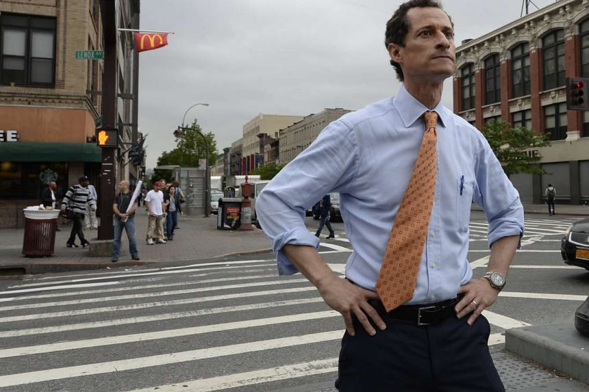 Former US Representative Anthony Weiner greeting residents in the Harlem neighborhood of New York City, on May 23, 2013.