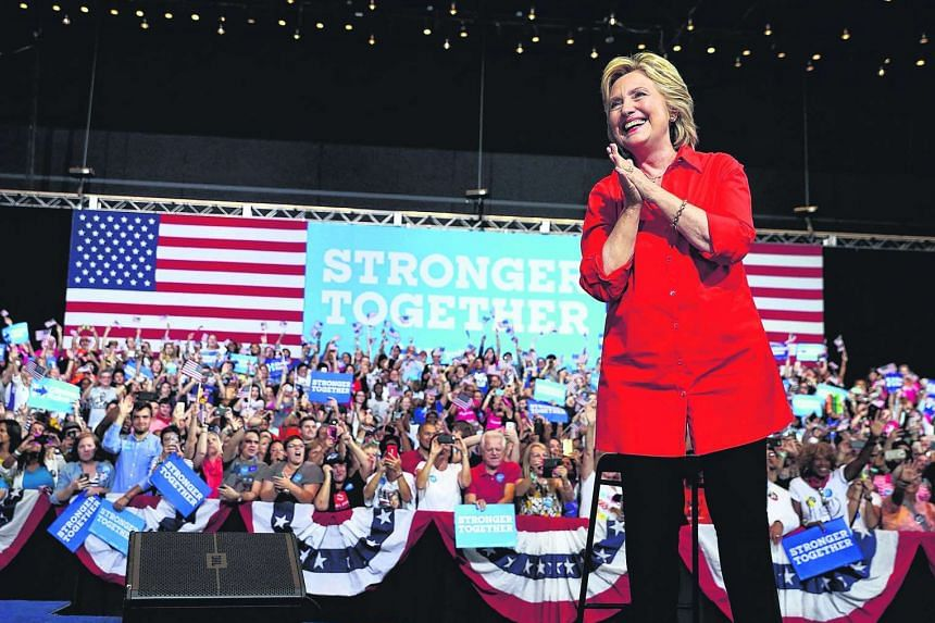 Democratic presidential nominee former Secretary of State Hillary Clinton greets supporters during a campaign rally at the David L. Lawrence Convention Center on July 30, 2016 in Pittsburgh, Pennsylvania.