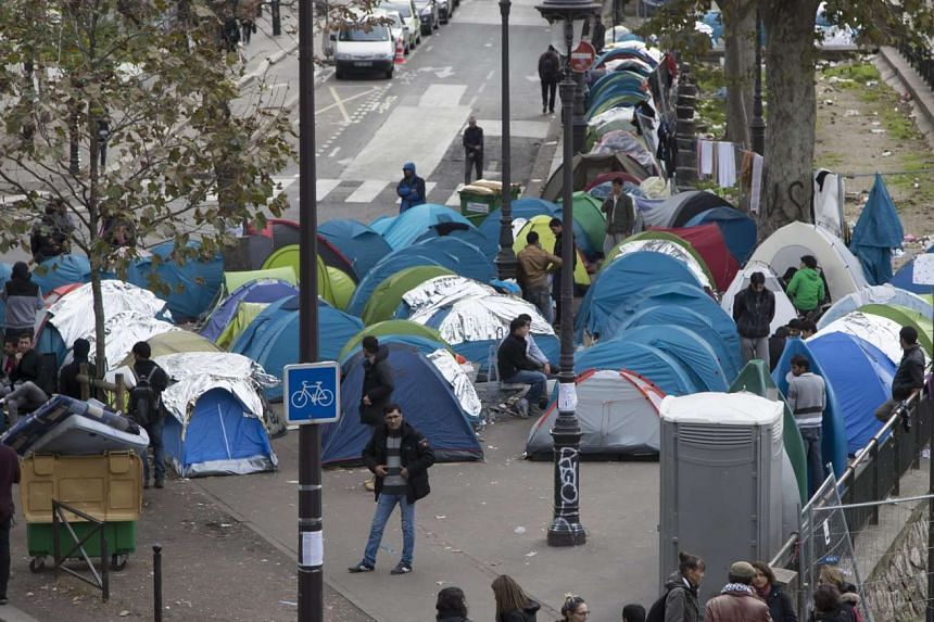 A general view of a makesA general view of a makeshift migrant camp set up near the Jaures and Stalingrad metro stations and the Canal Saint-Martin in Paris, France, on Oct 28, 2016.