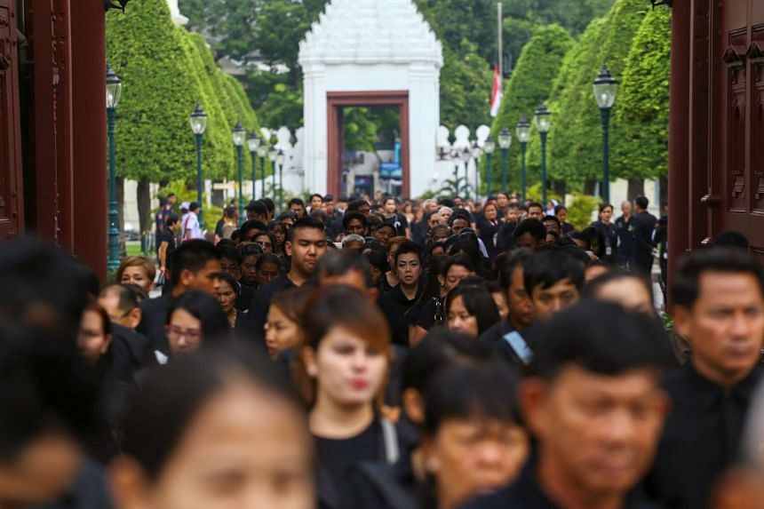 Mourners walking in line into the Throne Hall at the Grand Palace for the first time to pay respects to the body of Thailand's late King Bhumibol Adulyadej that is kept in a golden urn in Bangkok, Thailand, on Oct 29, 2016.