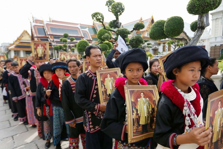 Mourners from the Kamphaeng tribe lining up to get into the Throne Hall at the Grand Palace for the first time to pay respects in front of the golden urn of Thailand's late King Bhumibol Adulyadej in Bangkok, Thailand, on Oct 29, 2016.