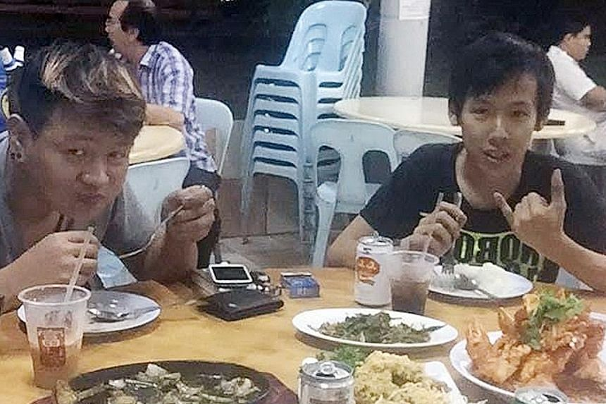 Mr Ong (far left) and Mr Ang having a meal together recently. Friends said the two were cycling in the West Coast area on Thursday because their friend, Marcus, The 34-year-old driver of this trailer truck has been arrested on suspicion of causing de