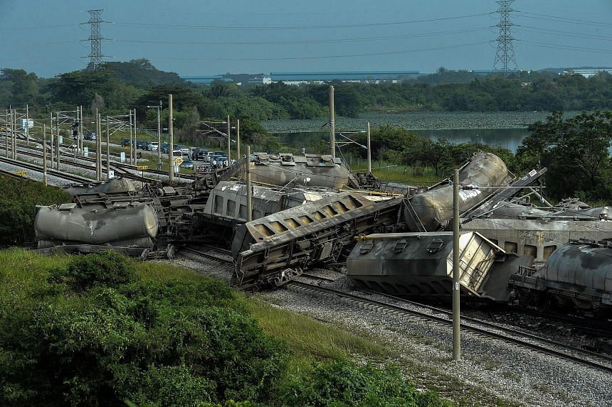 The derailed cargo train near Kampung Bakap in Perak yesterday. The accident affected rail services in the west coast, leading to thousands of stranded commuters. No explanation has been given so far on what caused the derailment. The driver and his