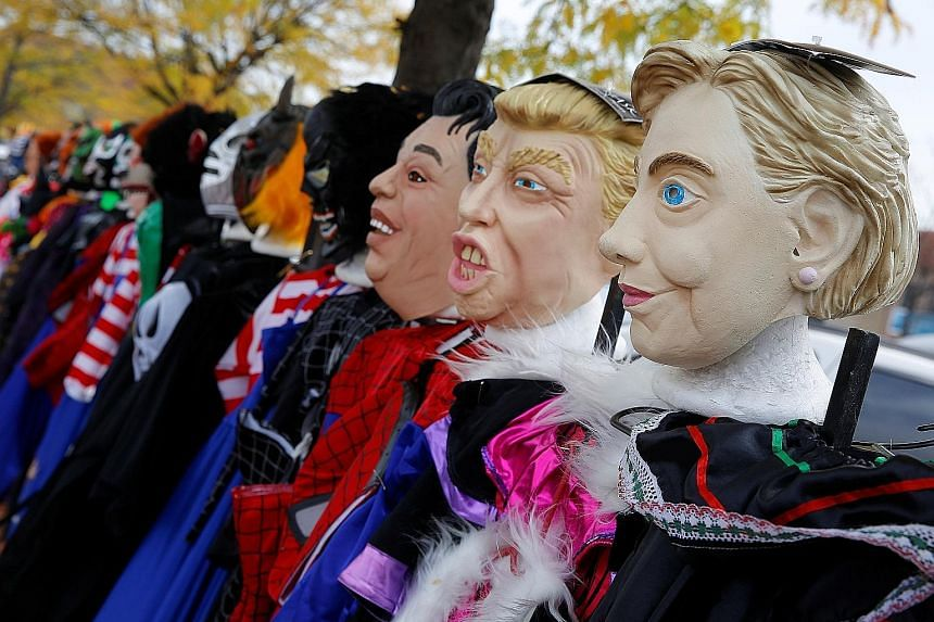 Halloween masks depicting candidates Hillary Clinton and Donald Trump for sale in Chicago. With the campaign in its last 10 days, there are still uncertainties as to what will happen after the election.