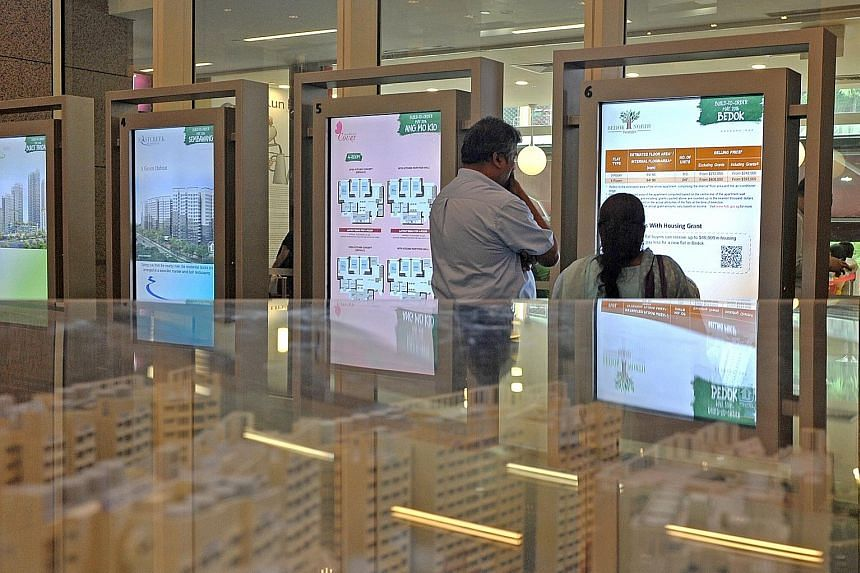 A couple viewing a display of BTO flats at the HDB Hub in Toa Payoh. MND says applicants stand a higher chance of success if they apply for flats in non-mature estates; most are able to secure a flat within two tries.
