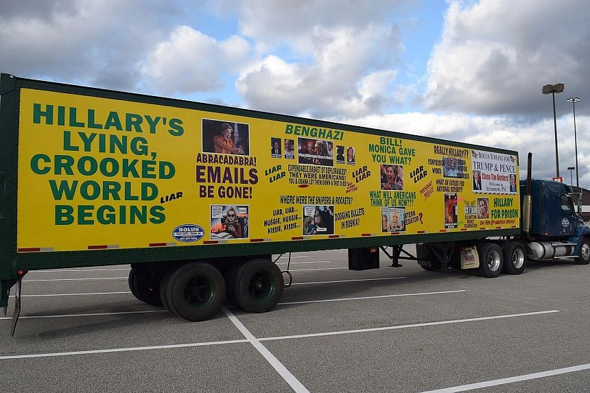 A truck parked at Cleveland's I-X Centre during Mr Donald Trump's rally last Saturday sums up the sentiments of many Republican supporters towards Mrs Hillary Clinton. Brecksville resident Gary Kasmer, who plans to vote for Mr Trump, in front of the