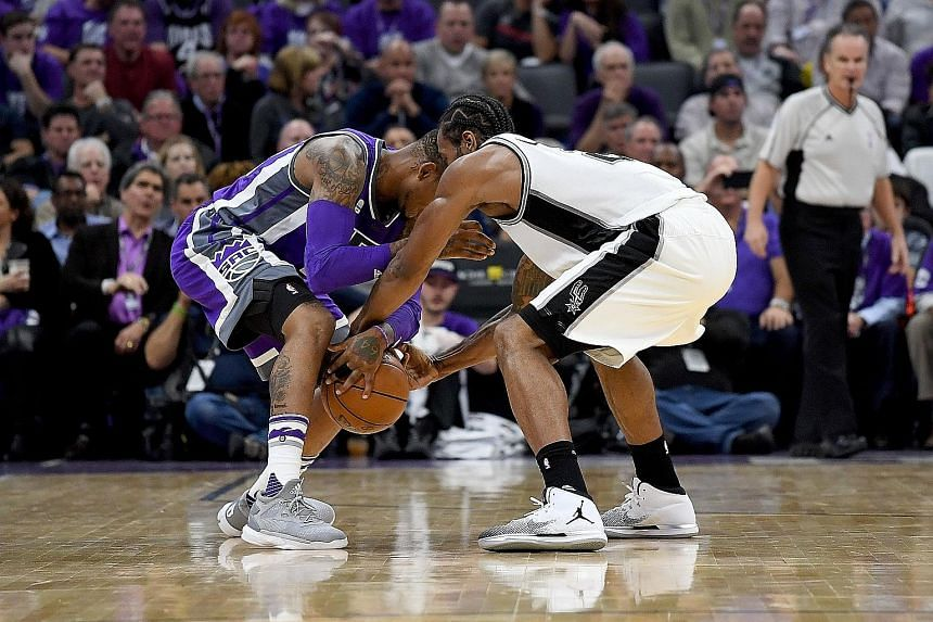 Spurs' Kawhi Leonard (right) steals the ball from Sacramento guard Ben McLemore during the third quarter of their NBA clash. The forward finished with five steals, and had a team-high 30 points in San Antonio's 102-94 victory at Golden 1 Centre.