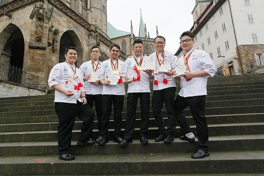 The winning team members: (from left) pastry chef Alex Chong, chef Roy Lim, chef Alan Wong, executive chef Louis Tay, chef Teo Yeow Siang and chef Triston Fang. They beat 29 other teams in Erfurt, Germany, to be the only Asian country to win two gold