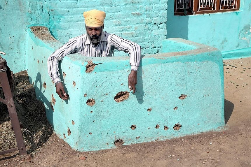 The pockmarked wall of a building damaged by alleged shelling from the Pakistani side of the disputed Kashmir border. Indian and Pakistani troops have exchanged fire several times this week in cross-border shelling.