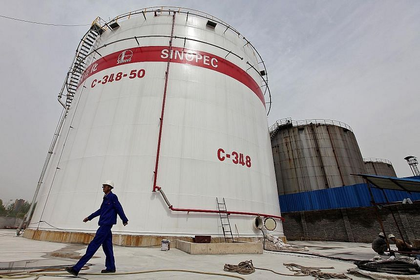 Oil tanks at a Sinopec refinery in Wuhan, Hubei province. Oil's two-year price slide starting in 2014 has been a boon to fuel makers, including Sinopec.