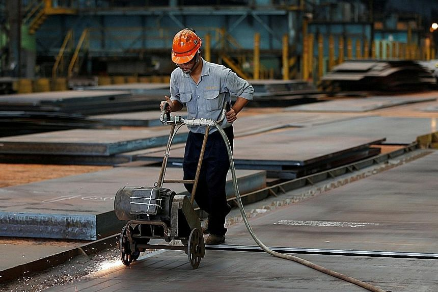 A steel worker at a factory in Kaohsiung, Taiwan. The island's export orders rose sharply more than expected last month as vendors stocked up on supplies for Apple's iPhone 7 and other gadgets to meet year-end demand.