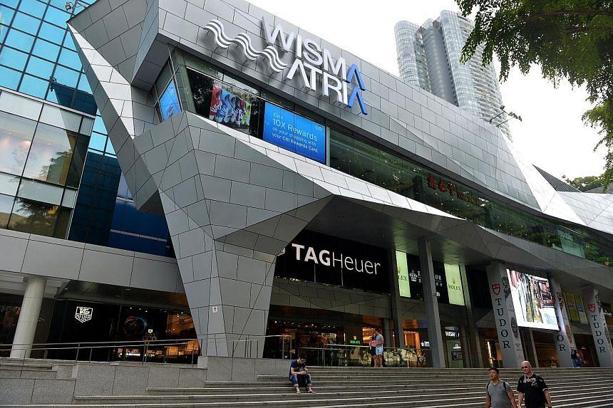 Starhill Global Reit's Singapore portfolio, comprising interests in Wisma Atria (left) and Ngee Ann City in Orchard Road, contributed 63.4 per cent of total quarterly revenue, or $35 million.