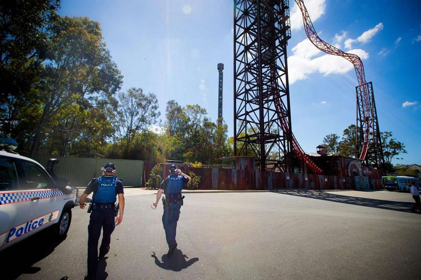Queensland police walk in the Dreamworld theme park on the Gold Coast on Oct 26, 2016.