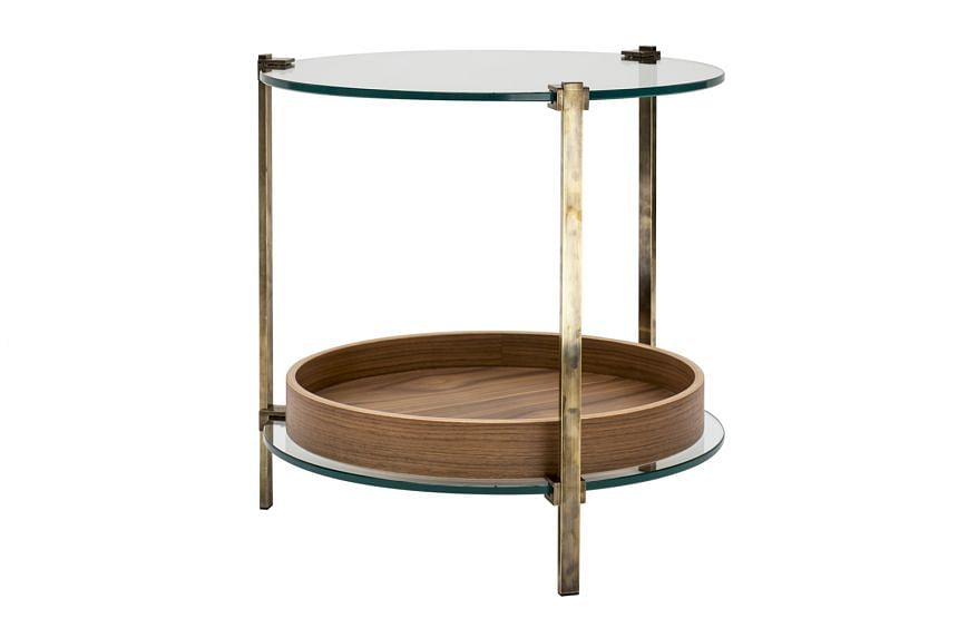 Side table with patinated brass legs.