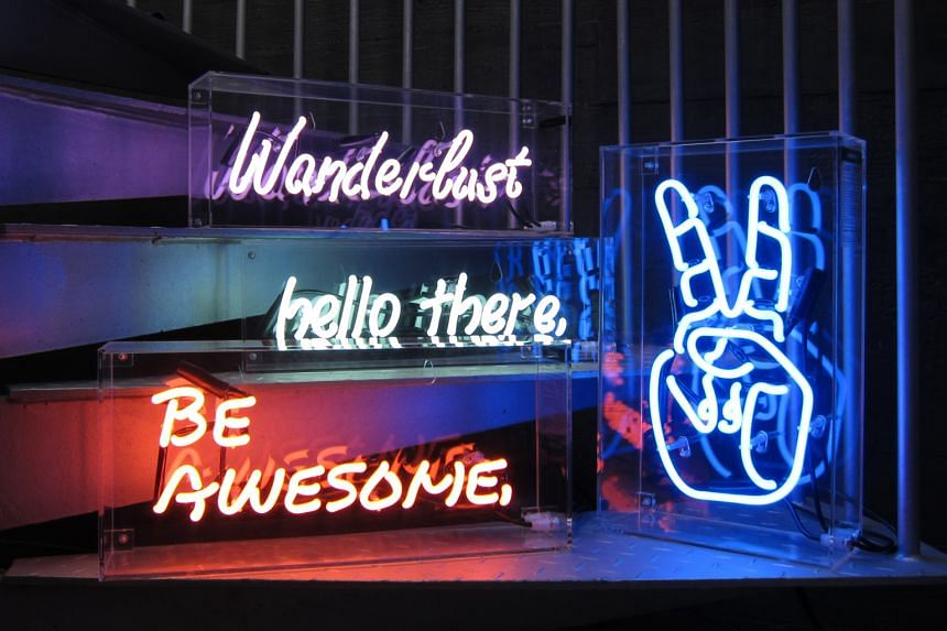 """Design Driven Goods' first collection has five neon light designs, including """"hello there"""", """"Wanderlust"""" and a hand flashing the peace sign (above)."""