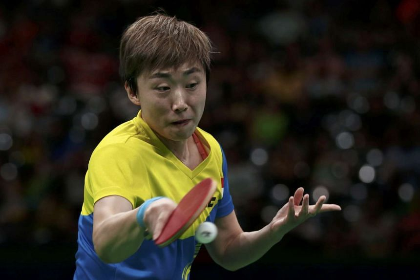 Feng Tianwei plays against Kasumi Ishikawa of Japan during the Women's Team Bronze Medal match at the 2016 Rio Olympics.