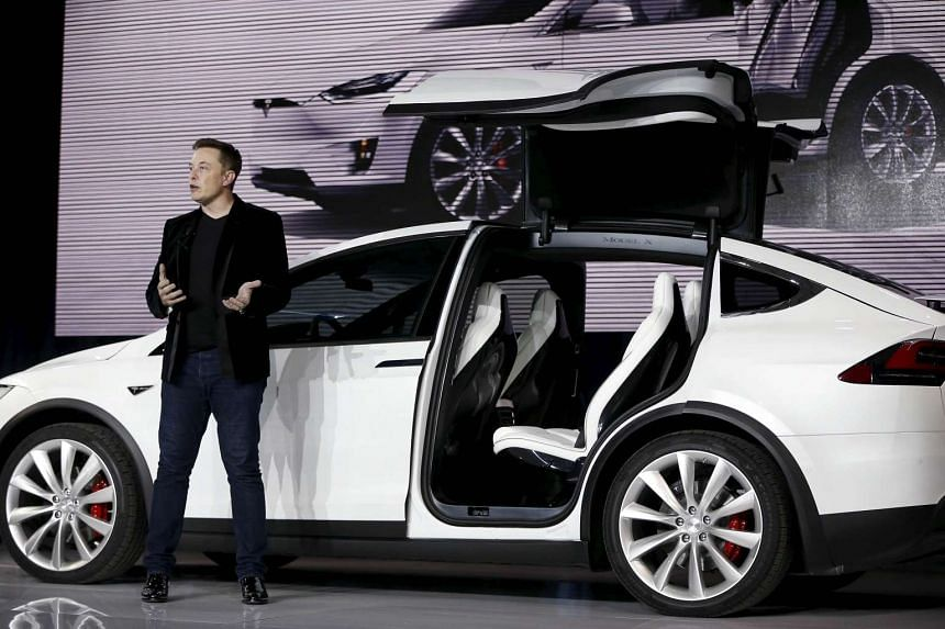 Tesla Motors CEO Elon Musk introduces the falcon wing door on the Model X electric sports-utility vehicles during a presentation in Fremont, California, US, on Sept 29, 2015.