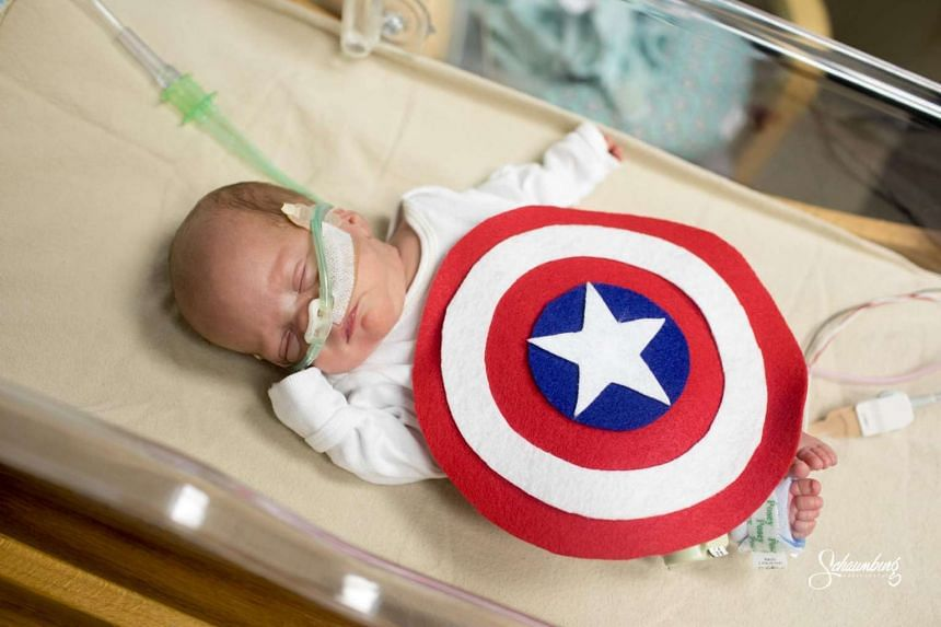 Some babies spent Halloween in a US hospital but donned superhero costumes to celebrate.