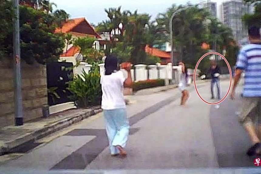 A screenshot of the video where the maids chased the man with bricks.
