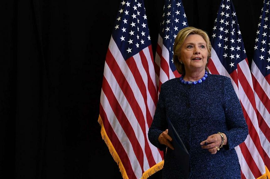 US Democratic presidential nominee Hillary Clinton leaves after giving a press conference about the FBI's reopening of a probe into her use of a private email server while secretary of State, in Des Moines, Iowa, on Oct 28, 2016.