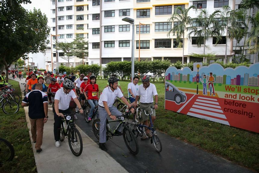 Senior Minister of State for Transport Ng Chee Meng and Dr Janil Puthuchear, Member of Parliament to Pasir Ris-Punggol GRC, at the flag-off event for the new Punggol cycling network on Oct 30, 2016.