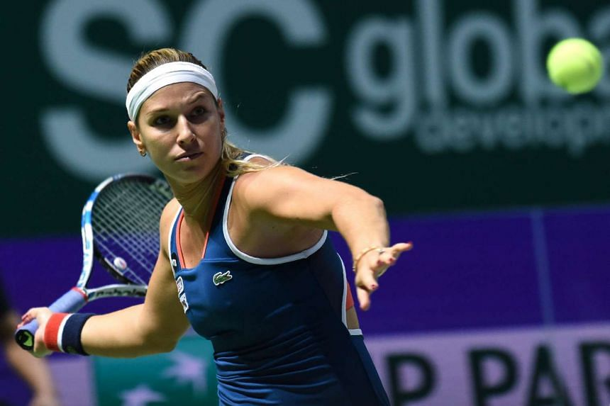 Dominika Cibulkova hits a return against Angelique Kerber during their women's singles final match at the WTA Finals tennis tournament in Singapore on Oct 30, 2016.