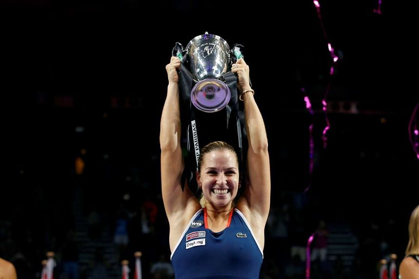 Dominika Cibulkova celebrates with her trophy after defeating Angelique Kerber at the WTA Finals tennis tournament in Singapore on Oct 30, 2016.