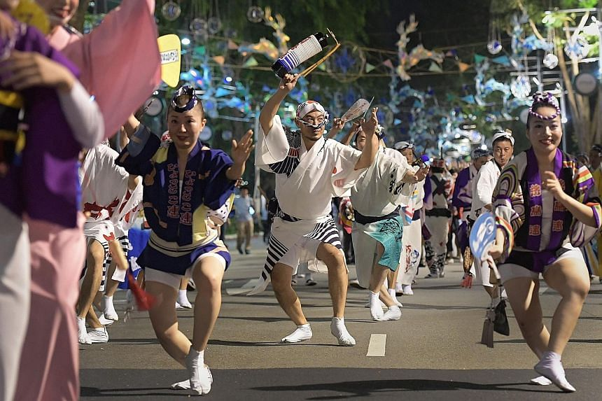 At the parade in Orchard Road, nearly 200 dancers, including top Awa Odori performers (left), entertained the crowds who later joined them.