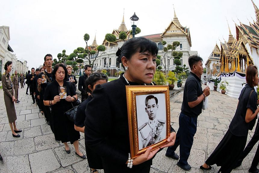 Thai mourners waiting yesterday to enter the Grand Palace to pay their respects to the late King Bhumibol, a demigod figure who endeared himself to the masses through his efforts to alleviate rural poverty. He was the only king that most Thais have e
