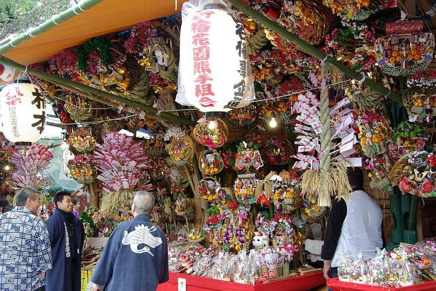 During Tori-no-Ichi, festivalgoers visit Otori-jinja shrines in Tokyo and buy lucky kumade - rakes made of bamboo, sold at stalls (left) around the shrines. In the Cayman Islands, thousands celebrate Pirates Week.