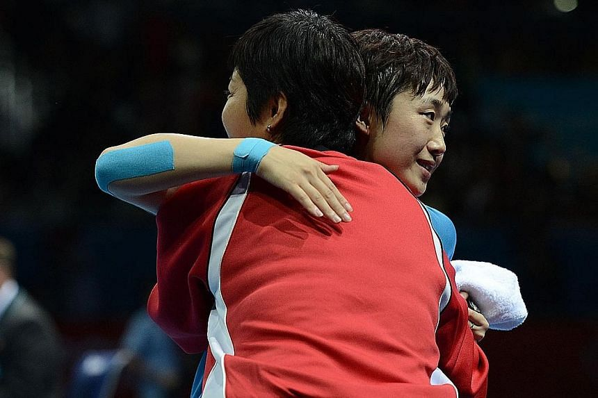 Above: Yang's services were terminated last November, 11/2 years before his contract was up. Left: Feng hugging Jing at the London Olympic Games in 2012. It is understood that the women's team, who had been led by Jing since 2013, had felt that their