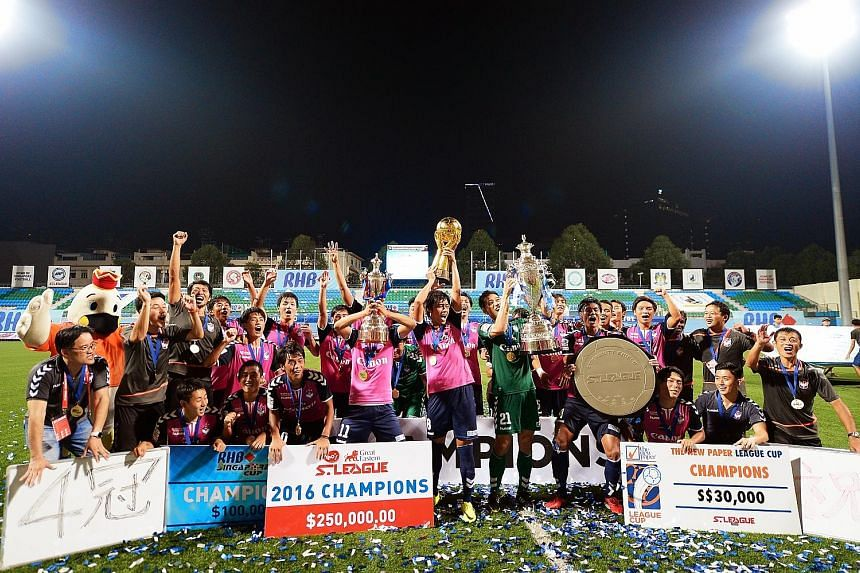 Above: Albirex Niigata with the four pieces of silverware they won this season - the Charity Shield, League Cup, S-League trophy and Singapore Cup. Left: Tampines star Jermaine Pennant in action after coming off the bench in the 68th minute, with his