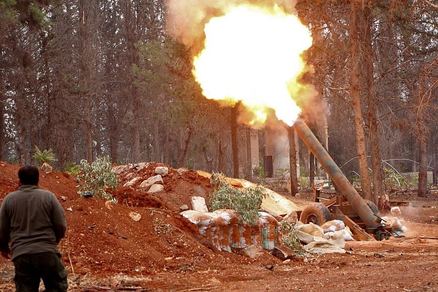 A rebel from the Jaish al-Fatah group on Friday firing a mortar during an assault on Syrian government forces focused on the western edge of Aleppo.