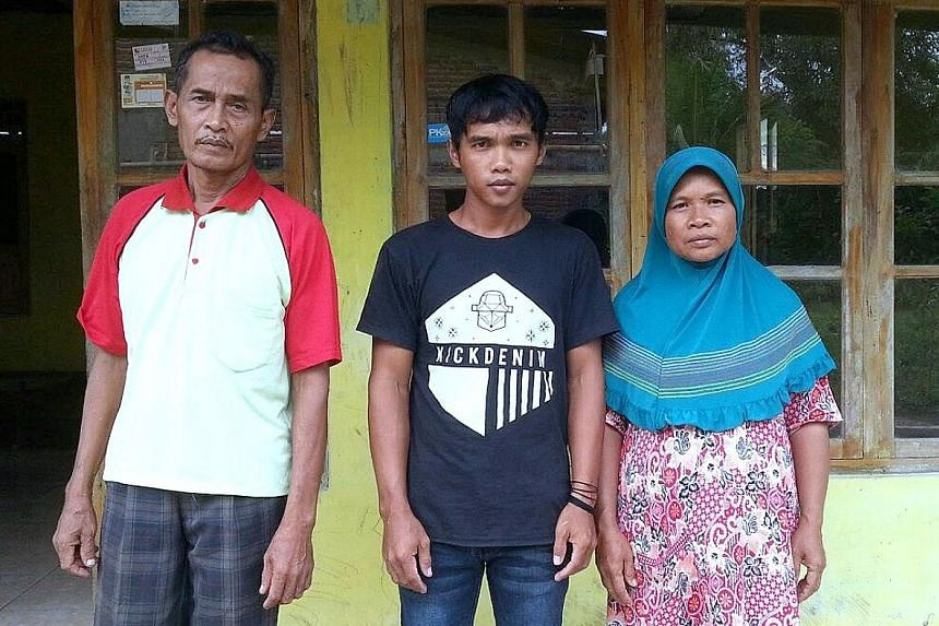 Indonesians Sumarti Ningsih (left) and Seneng Mujiasih were killed by British banker Rurik Jutting in Hong Kong in 2014. Below: Ms Sumarti's brother Suyitno with their parents Achmad Kaliman and Suratmi. The family is hoping justice will be served.