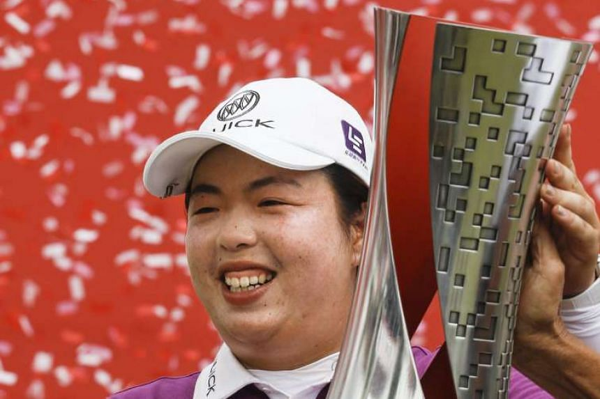 Feng Shanshan poses with her trophy after winning the Sime Darby LPGA Malaysia golf tournament in Kuala Lumpur on Oct 30, 2016.