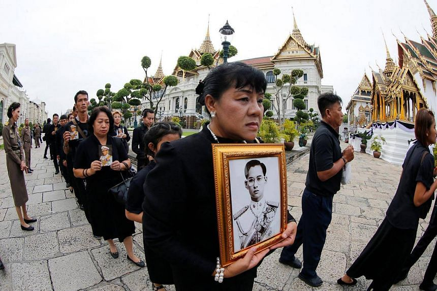 Mourners line up to get into the Throne Hall at the Grand Palace for the first time to pay their respects in front of the golden urn of Thailand's late King Bhumibol Adulyadej in Bangkok, Thailand on Oct 29, 2016.