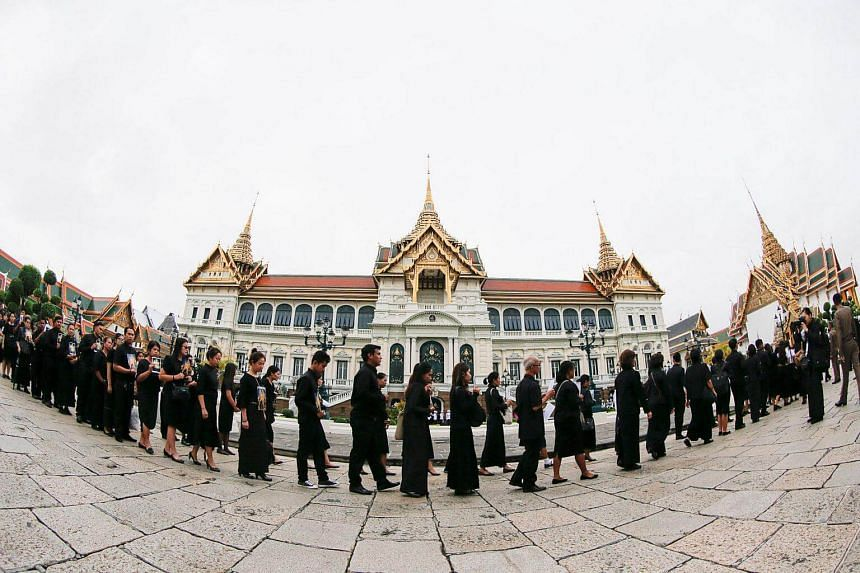 Mourners line up to get into the Throne Hall at the Grand Palace for the first time to pay their respects in front of the golden urn of Thailand's late King Bhumibol Adulyadej in Bangkok, Thailand, on Oct 29, 2016.
