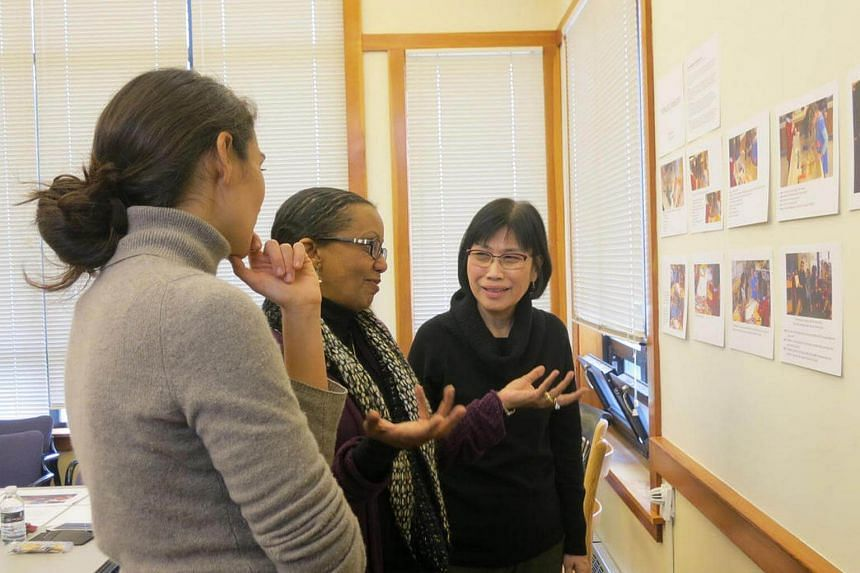 Singapore Hokkien Huay Kuan Preschool principal Tham Kum Fong (right) with director Dr Hanna Gebretensae (middle) and documentation specialist Sammeh Solaimani (left) of Eliot-Pearson Children's School in Boston on Oct 27, 2016.