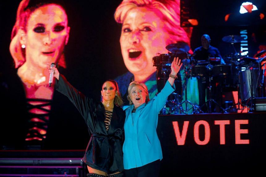 US Democratic presidential nominee Hillary Clinton joins performer Jennifer Lopez at a campaign concert in Miami, Florida, US, on Oct 29, 2016.