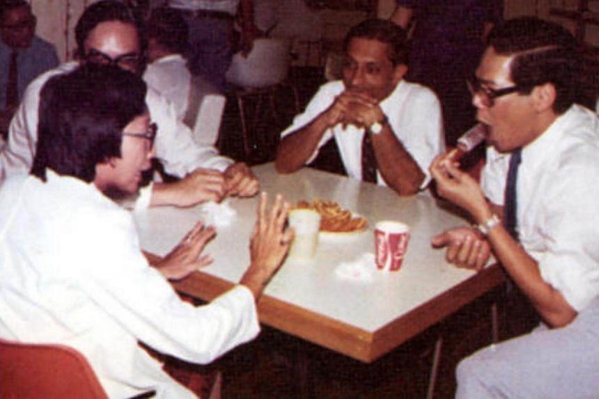Dr Kwa (right) taking a break with his colleagues in an undated picture.