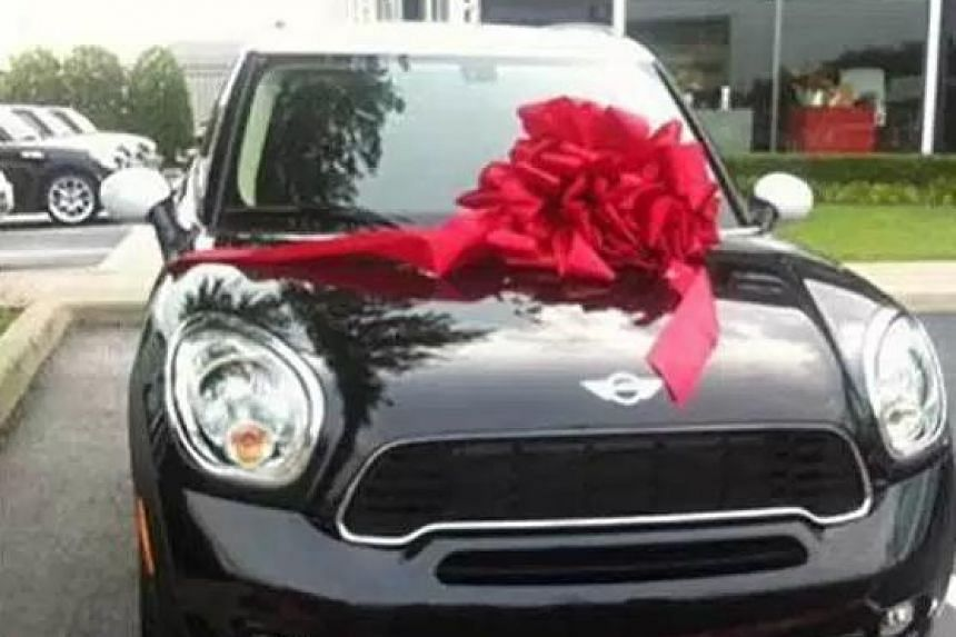 A scam Facebook page asked users to like and share the page for a chance to win a Mini Cooper.