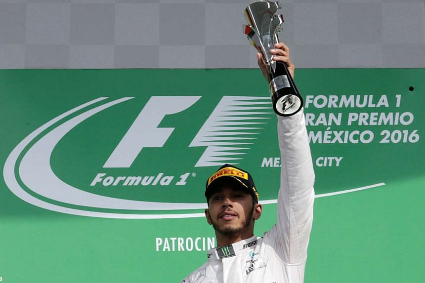 Mercedes' driver Lewis Hamilton of Britain celebrates after winning the Mexican F1 Grand Prix on Oct 30, 2016.