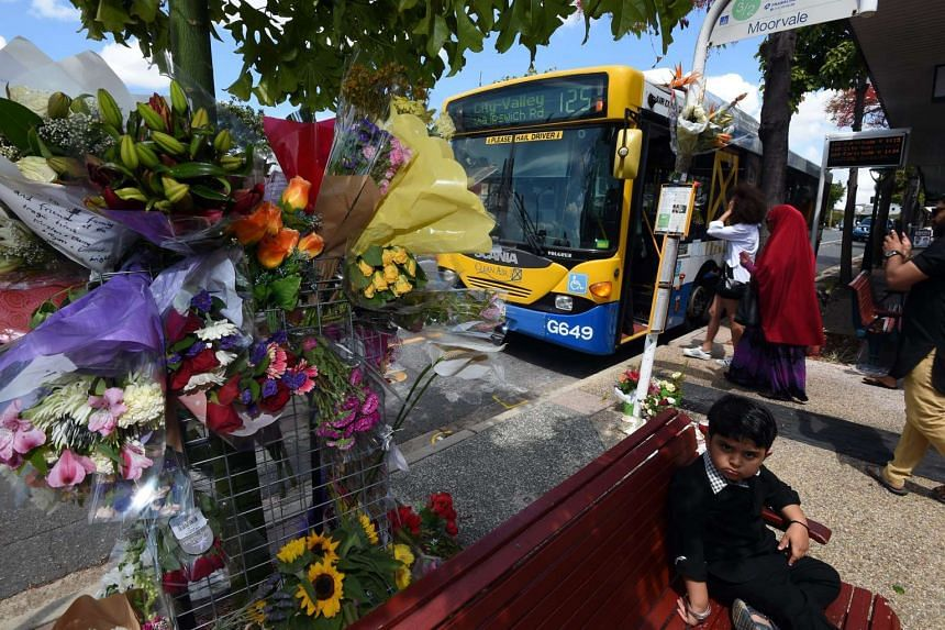 A floral tribute is set up at a bus stop, where bus driver Manmeet Sharma was murdered in Morooka, Brisbane on Oct 30, 2016.