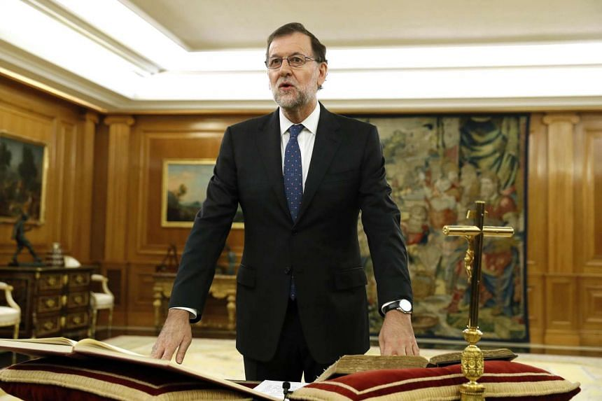 Spain's newly re-elected Prime Minister Mariano Rajoy swears an oath during a royal decree ceremony at the Zarzuela Palace in Madrid on Oct 31, 2016.