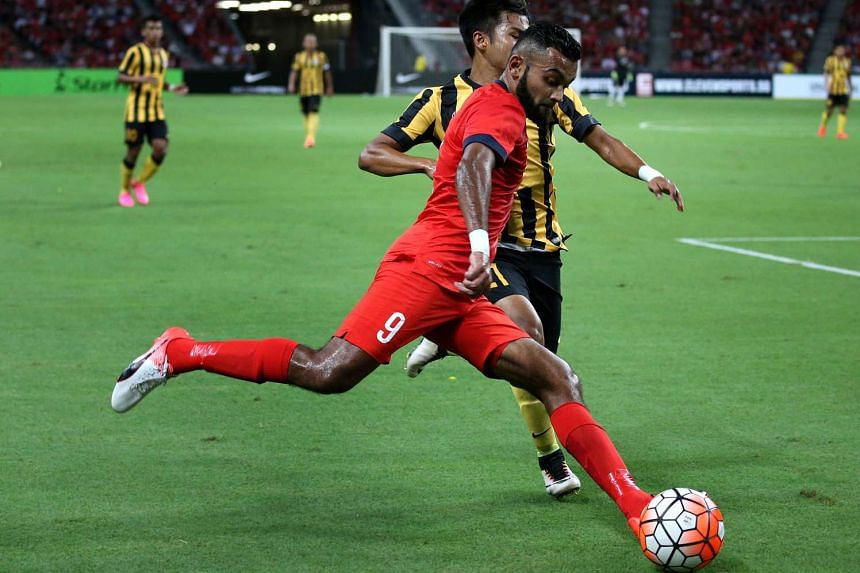 Lions Faritz Hameed (No. 9) in action during the match between Singapore and Malaysia at the Causeway Challenge at National Stadium on Oct 7, 2016. The match ended in a 0-0 draw.