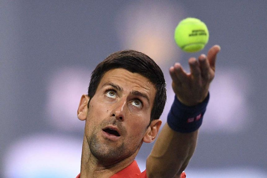 Novak Djokovic of Serbia serves against Fabio Fognini of Italy during their men's singles match at the Shanghai Masters tennis tournament in Shanghai on Oct 11, 2016.