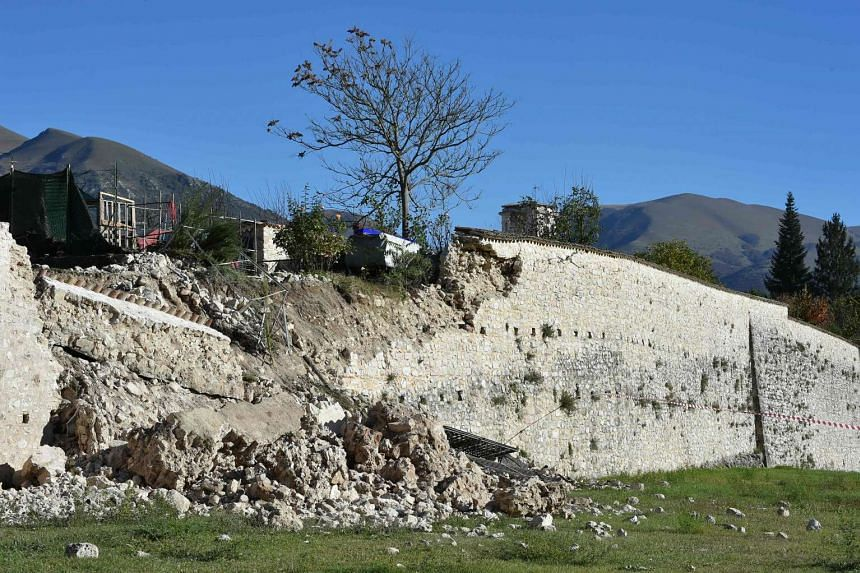 Collapse outside the center of Norcia after a 6.6 magnitude earthquake on Oct 30, 2016.